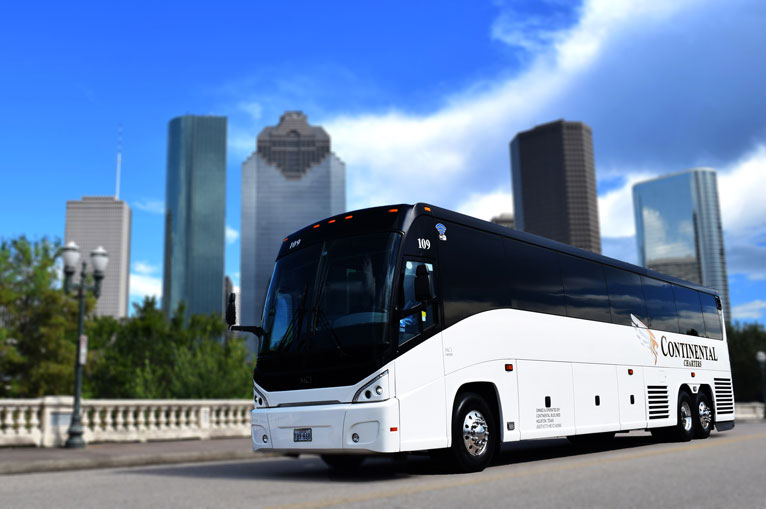 Group Charters Houston Texas Skyline White Luxury Bus In Front Of Buildings